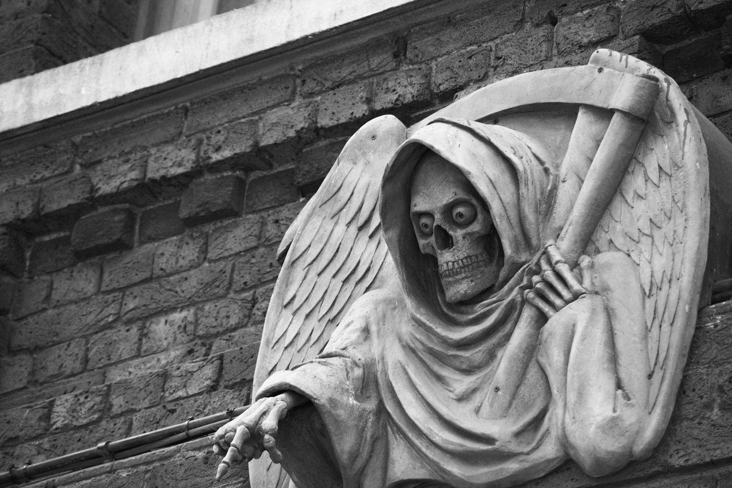 photo of a death statue outside the London Dungeon